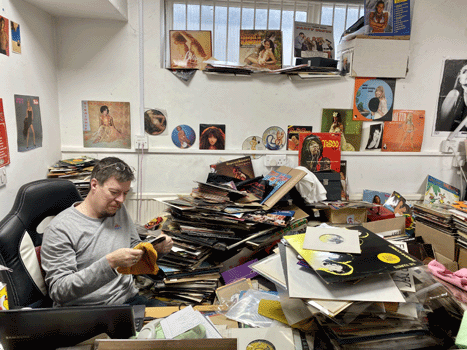 Mike cleaning records. The ones behind him are not good enough to sell